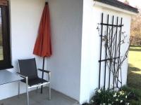 Ferienwohnungen Neuwiese - Blickauf Terrasse mit Rosengitter